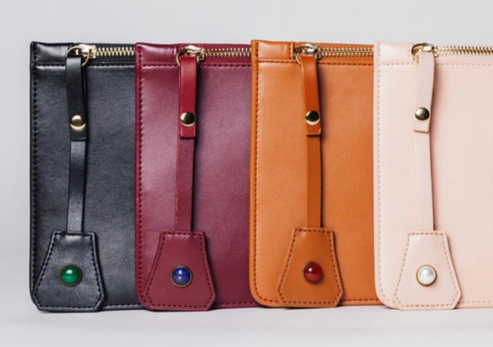 Rena Iman Leather Clutches | Luxury With A Purpose | CoffeeAndHandbags.com