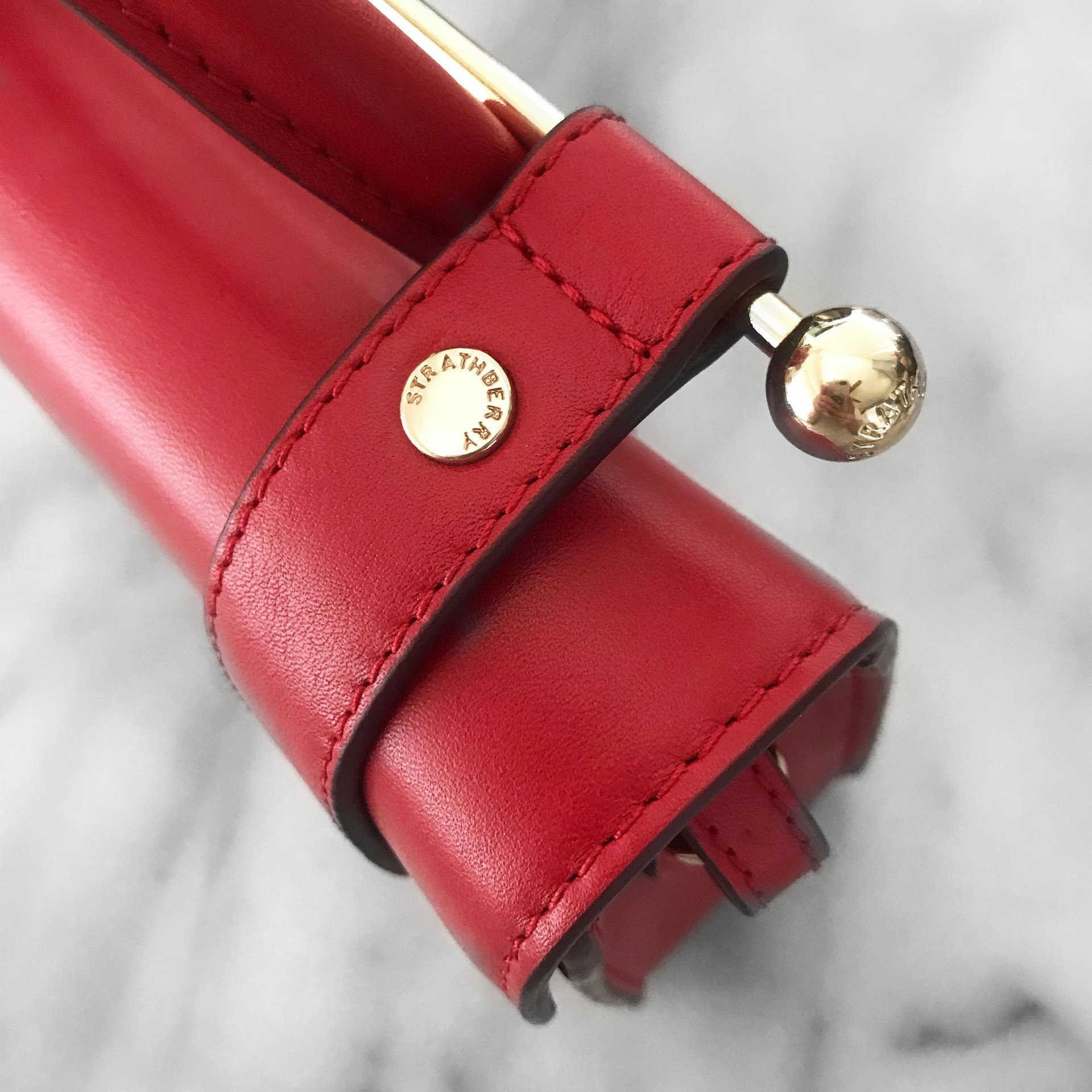 Strathberry Ruby Red MC Nano Hardware Details | CoffeeAndHandbags.com