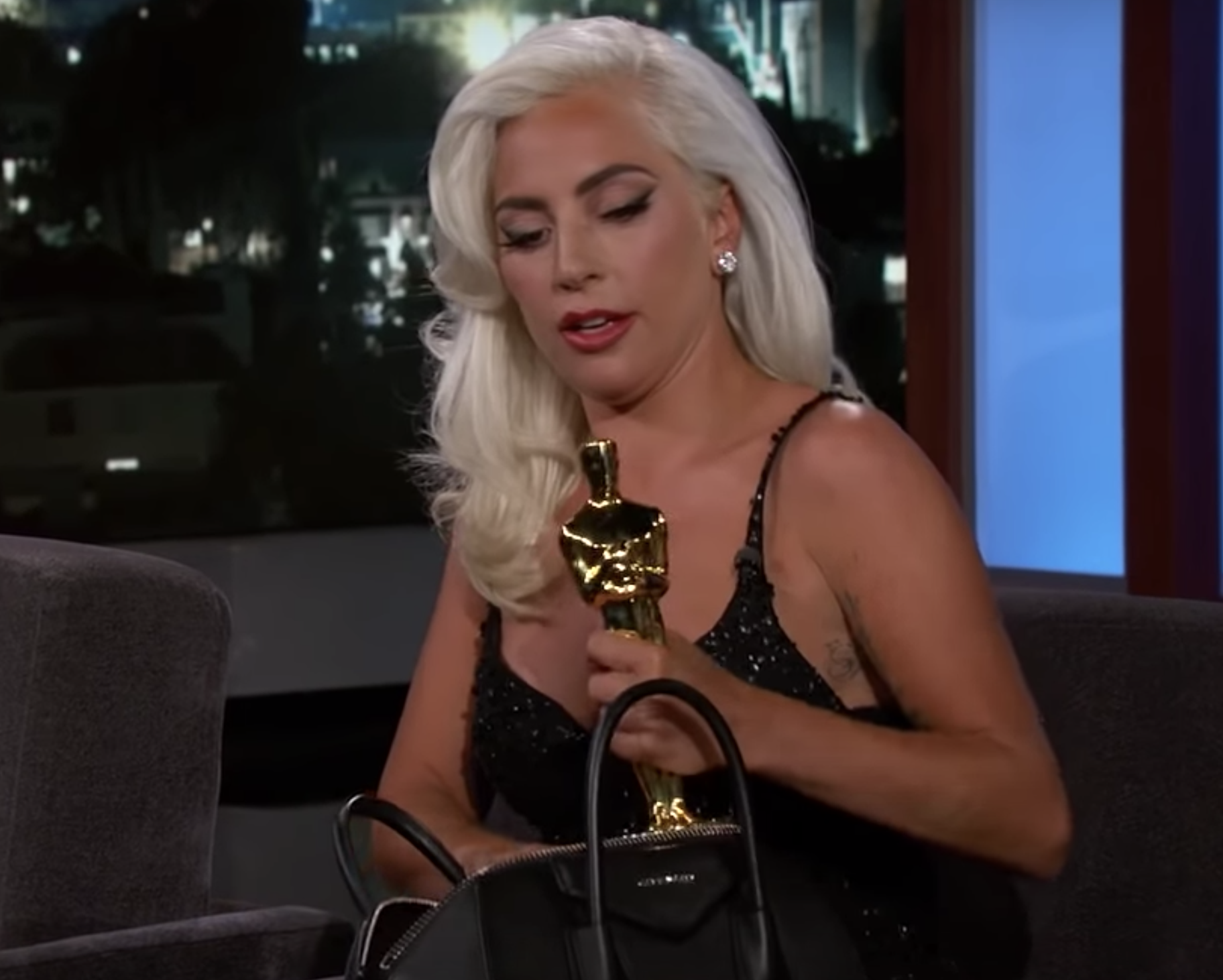 Lady Gaga on Jimmy Kimmel Live with her Oscar inside her Givenchy Antigona
